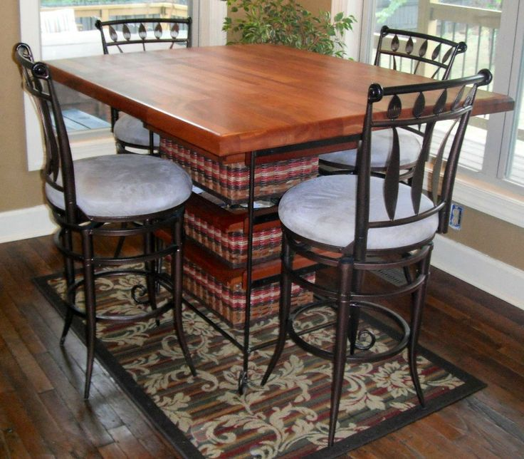 Table-36x45 pub table. This solid mahogany table will seat 4 comfortably and it will add charm and warmth to your kitchen. Also it is great for storage with the basket drawers.