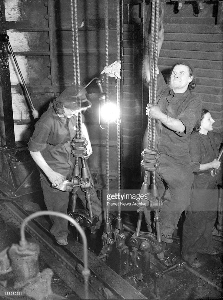 Women are now being employed on the Underground railway in London as lift cleaners and greasers. Dec. 1941