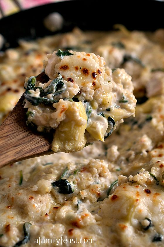 This recipe for Quinoa with Spinach, Artichokes and Chicken is pure, creamy and cheesy comfort food!