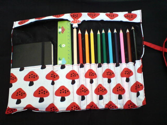 Pen/cil wrap with space for a book and ruler.