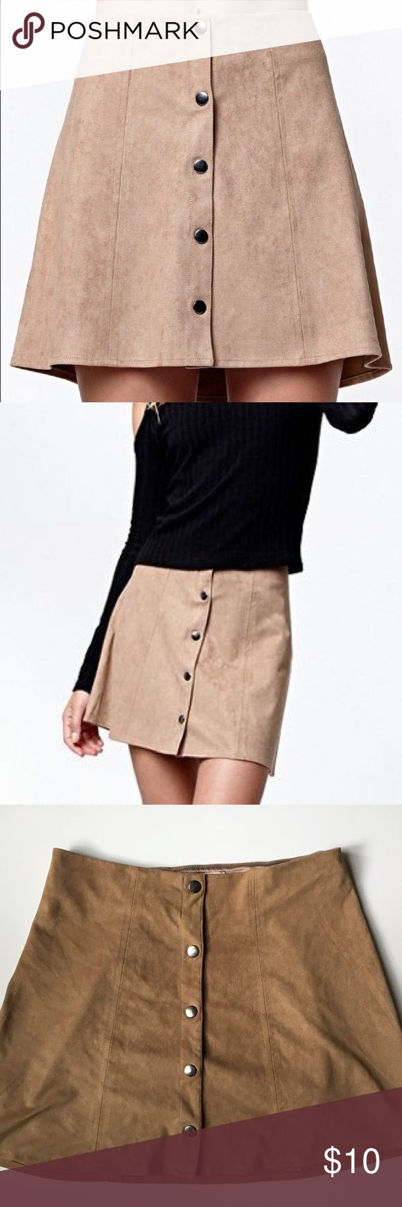 Kendall + Kylie Suede Button Skirt Cute skirt by Kendall + Kylie, perfect for spring/summer and for upcoming music festivals!! Not sure what the size is, it measures 13in across the waist and about 14in in length. There's a lot of piling on the inside back of the skirt, this does not affect the wear however! Price reflects the inside damage. Feel free to ask questions and make offers!!  Kendall & Kylie Skirts Mini