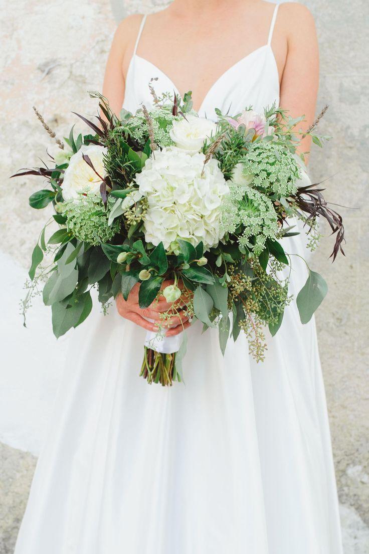 Hand-tied bouquet, white hydrangeas, Queen Anne's Lace, seeded eucalyptus, Charleston wedding // Priscilla Thomas Photography