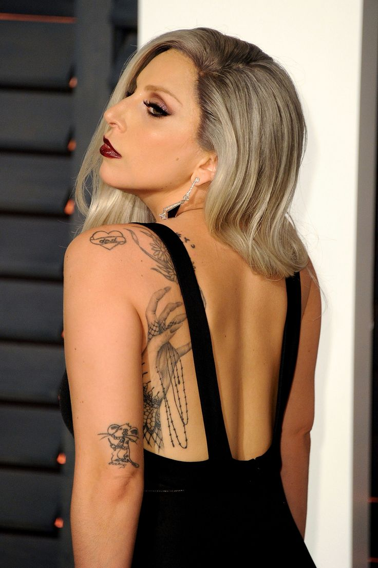 """19. That's how many tattoos decorate Lady Gaga's body. Get to know the meaning behind our favorites, including ones linked to David Bowie, Tony Bennett and her 2016 studio album """"Joanne."""""""
