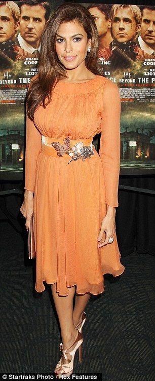 Eva in an orange Prada number
