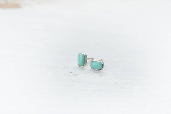 This is a sterling silver (hallmarked) and turquoise earring made in my studio. The little turquoise bead used to be part of native american vintage necklace made of natural american turquoise. I repurposed two beads to make this pair of stud earrings. Great colour for autumn, winter. Pale pastel blue-green colour. The earring has patina for enhancement. It comes with plastic backs. Size: 4 x 6 mm wide  Please check out my other items too, I hope one of them has your name on it!  I always…