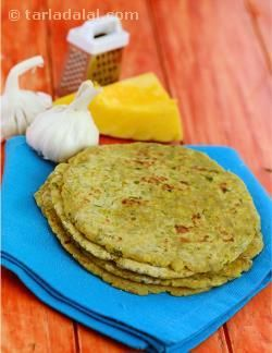 Wholesome and satiating, the Lehsuni Bajra aur Kaddu ki Roti is a perfect choice for those days when you are hungry enough to eat up everything in your larder but do not have enough time to cook! Just enjoy these tasty garlic flavoured bajra rotis with a bowl of low-fat curds and salad and your meal is done. Iron and fibre rich bajra along with garlic helps control cholesterol and keep your heart healthy.