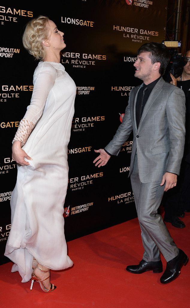 Jennifer Lawrence & Josh Hutcherson from The Hunger Games: Mockingjay Part 2 Premieres  Jennifer in Dior Couture and Josh in a gray suit