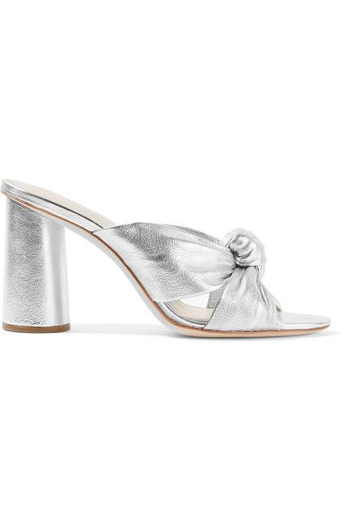 """We approach each season from the perspective of what we want to have in our own wardrobes,"" says Loeffler Randall. Made from silver leather, these timeless 'Coco' mules pay homage to well-worn favorites - the gathered front is inspired by knotted T-shirts. Wear them with everything, making sure that your layers are just short enough to show them off."
