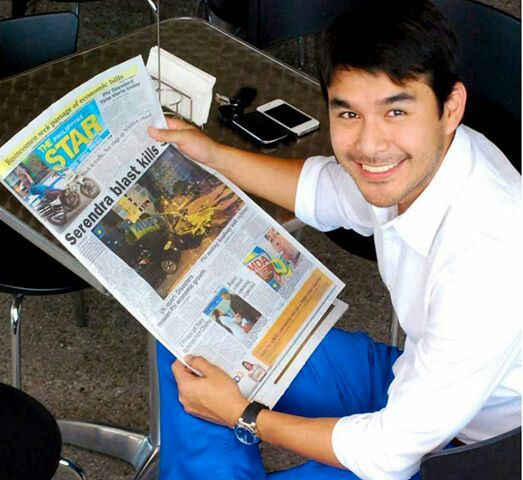 Atom Araullo reading Newspaper