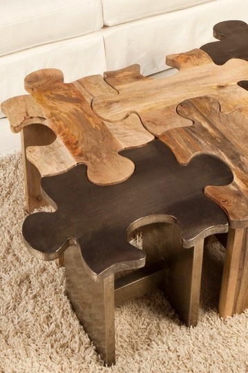 "Journey  Puzzle Silver Stool  The Puzzle stool / table is a great conversation starter. With is unique puzzle pieces combined to make a perfect master piece.  - Puzzle motif  - Mango construction  - SIlver finish  - Sold individually   - 22.5"" W x 14"" D x 17"" H  Retails for $600.00"
