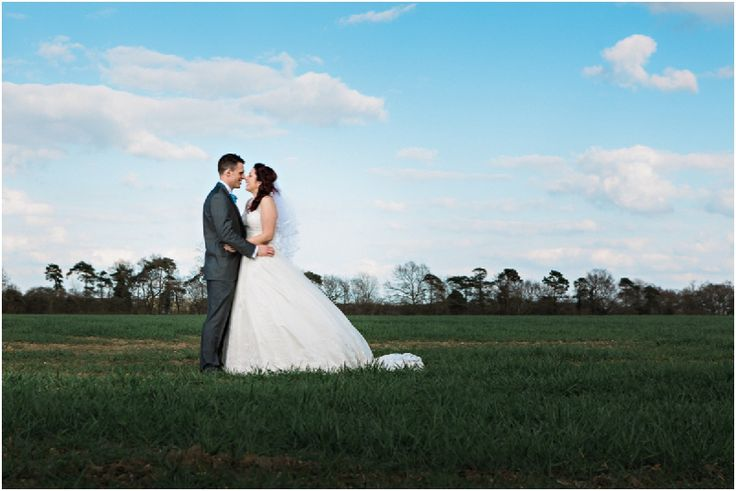 Suffolk Wedding Photography-Mark and Becky #suffolkvenue #granarybarns #granaryestates #weddingvenue #fields #weddingphotos #weddingdress #bluesky