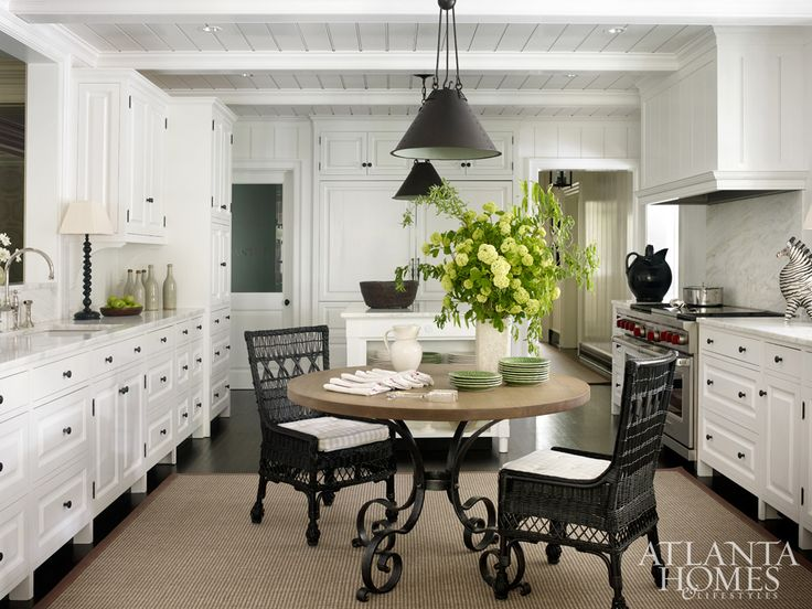 The bright kitchen, while generous, was actually reduced in size and relocated to carve out additional space for a laundry room, half bath and pantry.