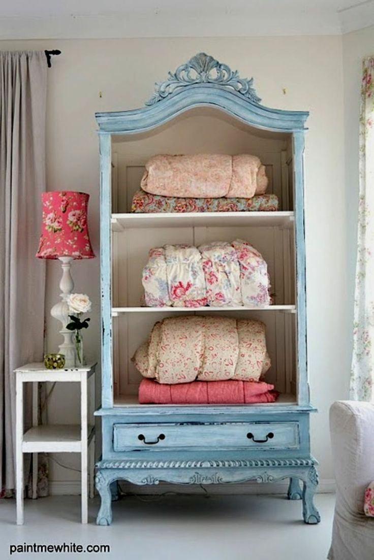 An old China Cabinet ( doors removed ) or a Bookcase can been upcycled for Storing Quilts and Blankets. Use for Personal use, Guest Room, At the Cabin... your choice :)  LARGE photo
