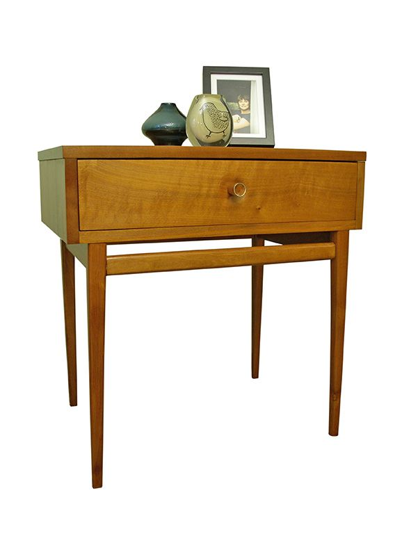 Bed side table. Designed by Fred Lowen for Fler. The handles are solid myrtle with a brass band around the ends. The legs are tapered and long.