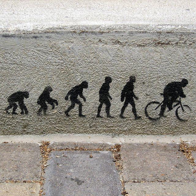 Ihmisen evoluutio. Stencil-graffiti Austinista, Texasista.