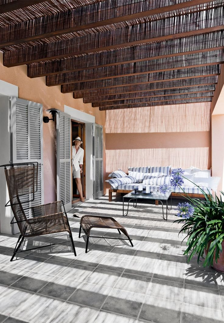 Tropical Covered Terrace In Delicate Tones With Modern Garden Lounge  Furniture In Mallorca.