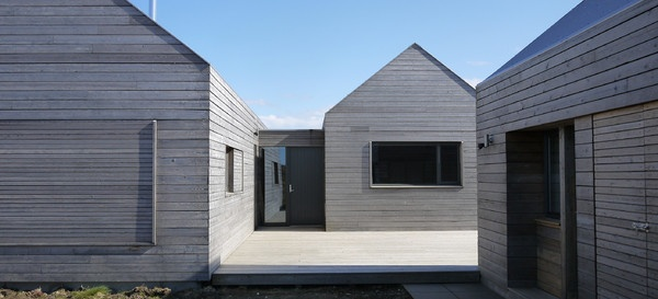 Siberian Larch cladding weathered to a silver/grey - Dualchas Architects | Russwood.co.uk
