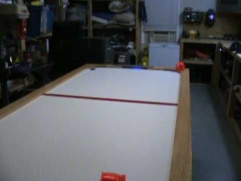 DIY AIR HOCKEY TABLE ---- This is a custom built Air Hockey table. It is a full size 4 x 8 table with oak skirt & trim. It has neon lights in the goals and above the table for glow in the dark play.