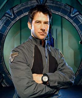 Joe Flanigan as Col. John Sheppard wearing a black Suunto Vector watch.