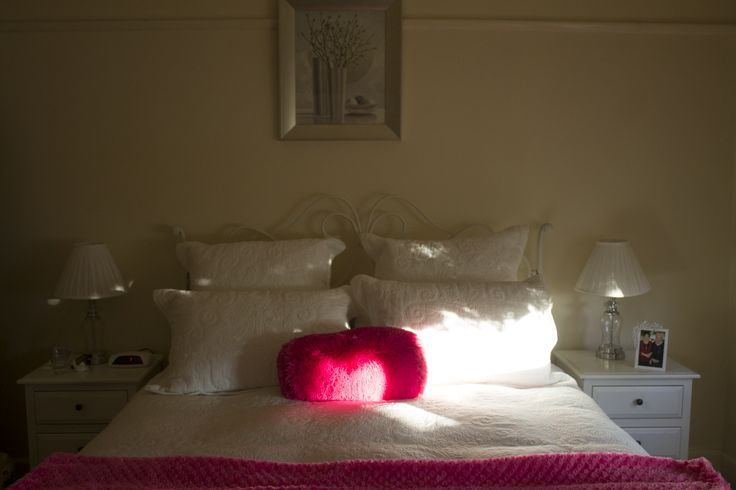 i love the lighting in this image, and how you can see the contrast of the two bed sides.