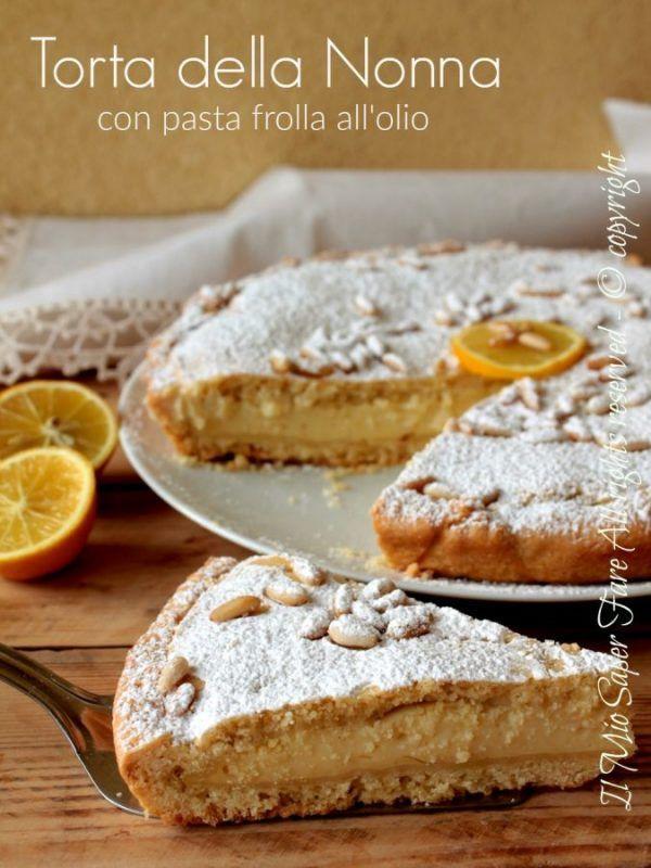 Torta della nonna ricetta facile con pasta frolla all'olio senza burro e pinoli tostati. Due dischi di pasta frolla friabile racchiudono la crema pasticcera