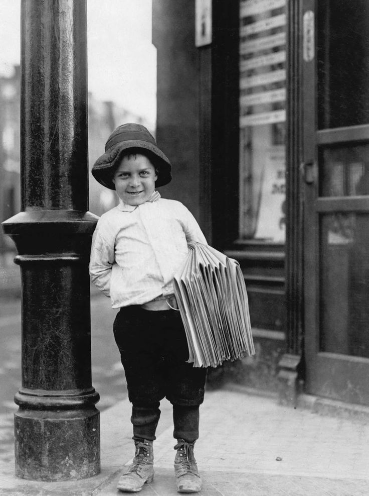 Lewis Hine. 'Newsboy. Little Fattie. Less than 40 inches high, 6 years old. Been at it one year' St. Louis 1910 Missouri