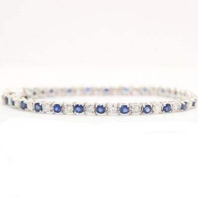 Who needs fancy ostentious jewelry when one can wear this stunning 6.17 carats sapphire and diamond 14k white gold bracelet that can add to your glamour.