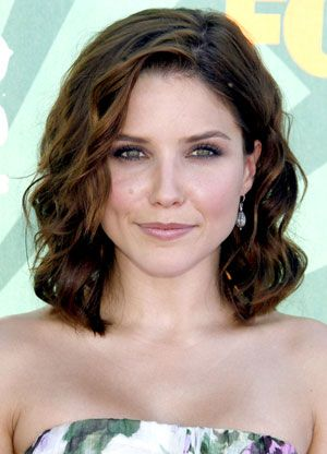 Beachy waves and a side-part give Sophia Bush's bob a tousled finish.