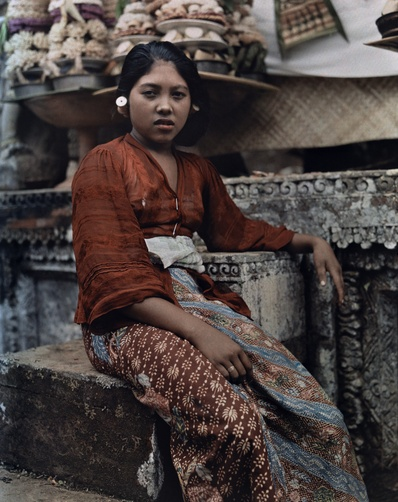 Maynard Owen Williams. An informal portrait of a young girl sitting on the steps of a temple. Bali, Lesser Sunda Islands, Indonesia. 1920s.