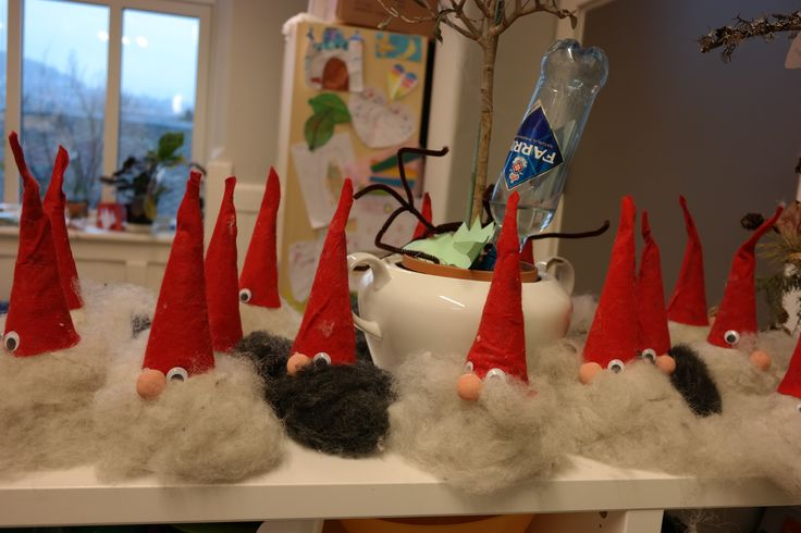 """For Christmas our class made """"nisser"""" for gifts to their parents. We used a Styrofoam cone for the base, precut the red hats from felt, and used real wool for the beards! Again the teachers made one along with the class to show how to do it."""