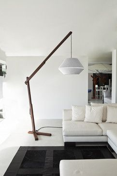 his wooden cantilevered floor lamp is rustic and playful yet modern, with a style that reminds me of Frank Lloyd Wright and Japanese rice pa...
