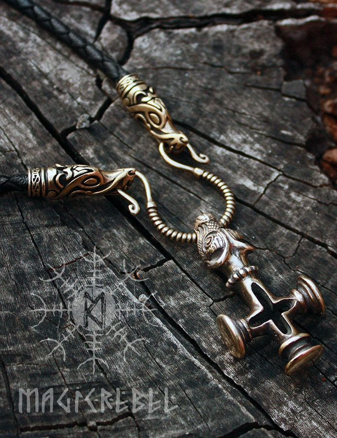 This is a real solid bronze Thor's Hammer Olaf Cross and optional genuine leather handmade braided necklace with solid bronze wolf head connectors.  The Thor's Hammer Cross or Olaf Cross is a mini replica of a pendant found in Fossi, Iceland which shows how the Vikings balanced between Norse religion and Christianity.   #magicrebel #bronze #thor's #hammer #olaf #cross #wolf #mjolnir #handmade #genuine #braided #leather #necklace