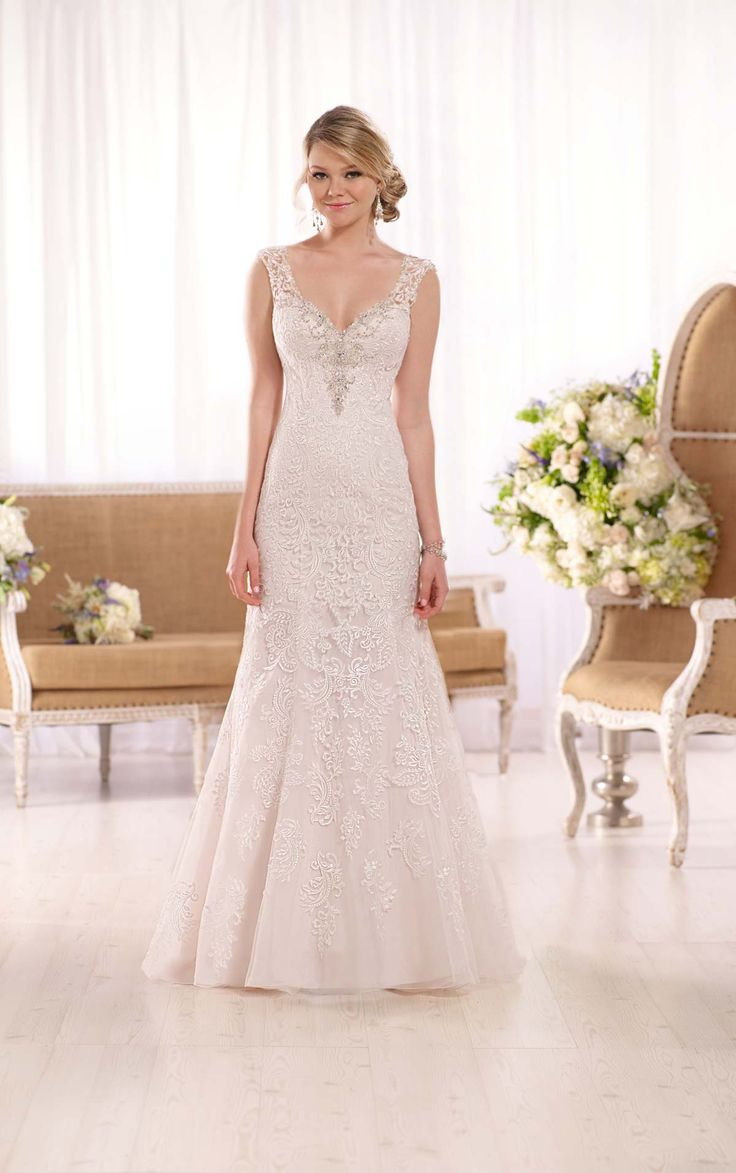 Trending This stunning wedding dress from the Essense of Australia collection features swirls of romantic corded lace on an A line tulle over matte side satin