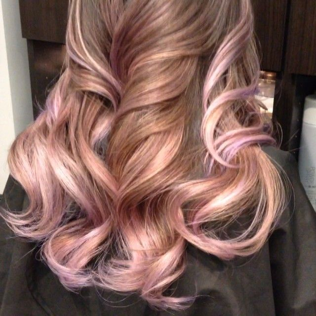 Beautiful hair with golden highlights including rose gold, subtle pink and lavender! | The HairCut Web! Highlights for me would be the only way to go to incorporate a little colour into my hair. I am pretty golden/caramel already so thinking when I go on maternity leave to add a little fun to my hair! A subtle rose gold or lavender in honour of my baby girl because I can...