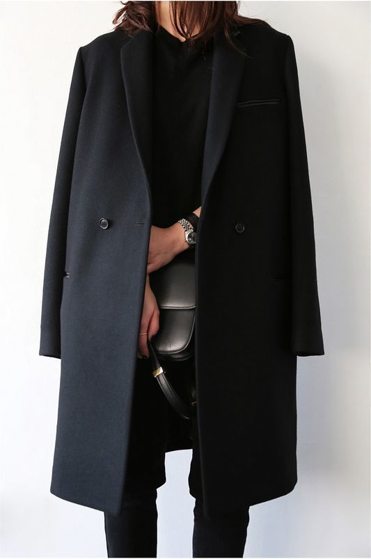Wear a black coat with black slim trousers to feel confidently and look…