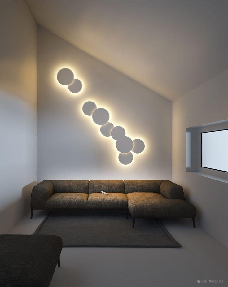 CENTRSVET   ECLIPSE  Настенные светильники могут не только освещать, но и создавать отблески и удивительные рисунки на окружающих поверхностях. Они во многом определяют качество пространства, решая, что заслуживает света, а что лучше оставить в тени.  Дизайн серии ECLIPSE напоминает солнечное затмение. Вокруг каждого из дисков можно увидеть корону света, а сам светильник практически парит над стеной.   Серия представлена дисками двух диаметров, белого и коричневого цвета. Удобные крепления…