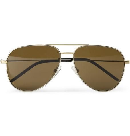Sleek, subdued and quintessentially sophisticated, Saint Laurent's aviator sunglasses have the hallmarks of Mr Hedi Slimane's new direction. The two-tone metal frames and pin-thin arms take... More Details