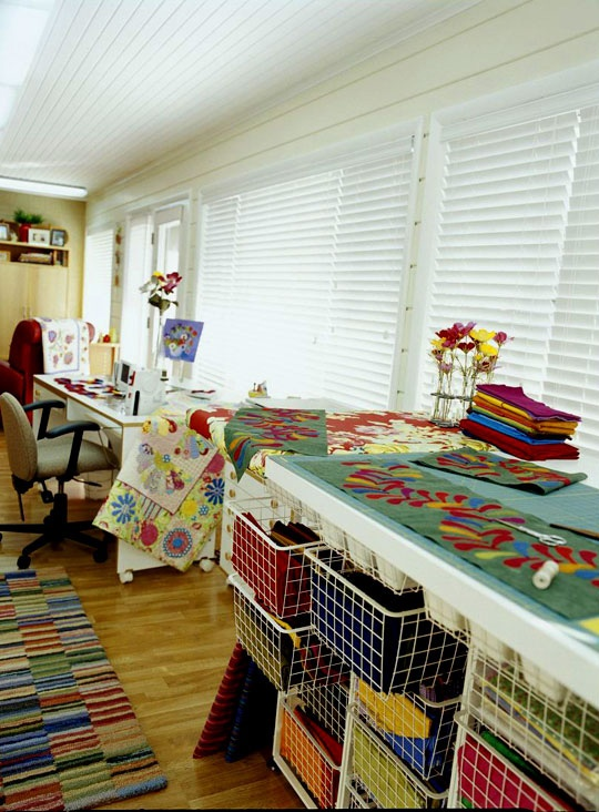 Have a sewing room with a view? Tailor your storage to work with the space you have. In this room, low and broad storage is the best option to prevent obstructing the windows.