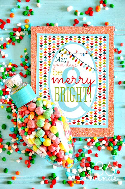 Fill up Plastic Ornaments with candy get the Free Christmas Printable at the36thavenue.com and you have a Merry and Bright gift idea for under $2! #supercute