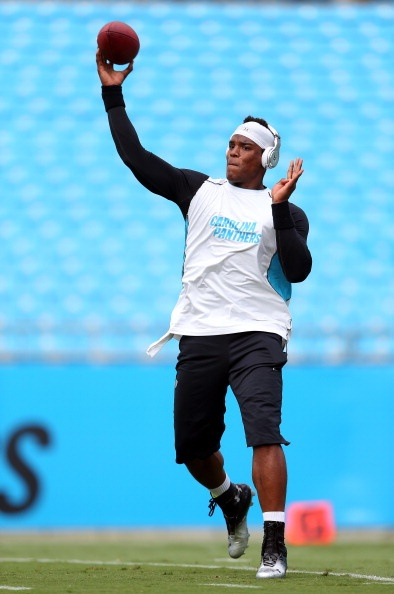 Cam Newton #1 of the Carolina Panthers warms up before their preseason game against the Miami Dolphins at Bank of America Stadium on August 17, 2012 in Charlotte, North Carolina. (Photo by Streeter Lecka/Getty Images)