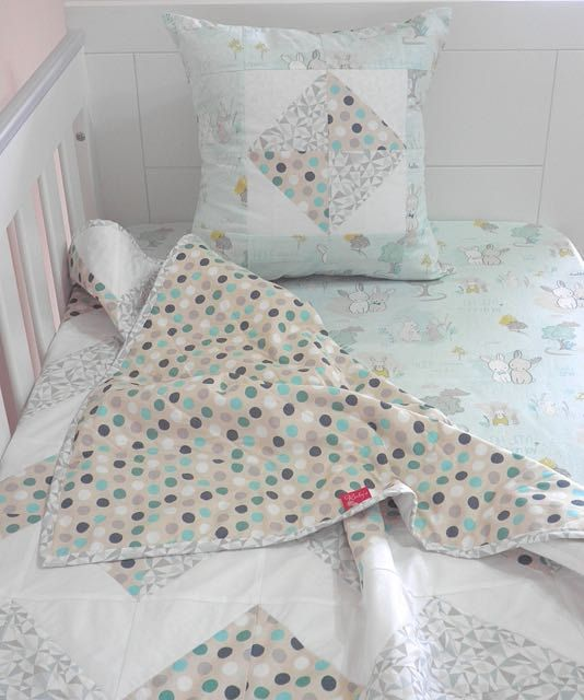 "Are you looking for something special, with style and quality for your baby? If you answered ""yes"", then your baby will be sleeping on quality bed linen with this one of a kind cot set - comprising a standard size fitted sheet, handmade patchwork quilt and co-ordinating lined cushion cover."