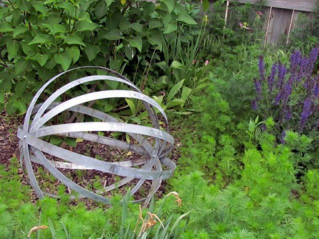 The Peaceful Axolotl: Wine Barrel Hoop Yard Globe- maybe with mini blinds? could be painted to look metal.