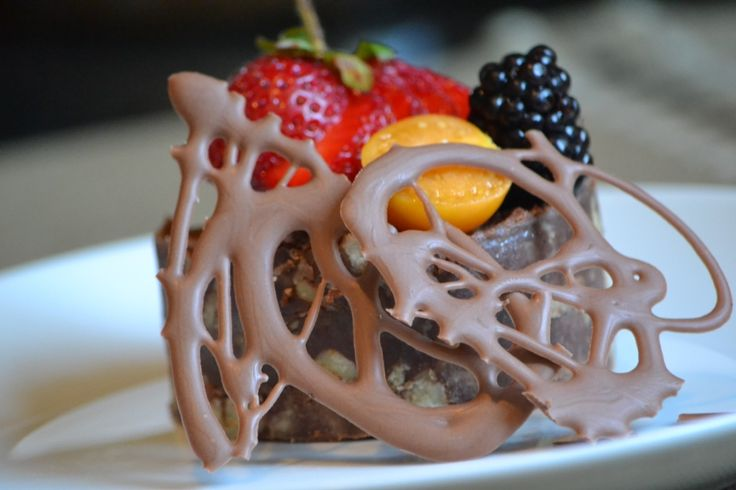 Chocolate brownie topped with summer berries