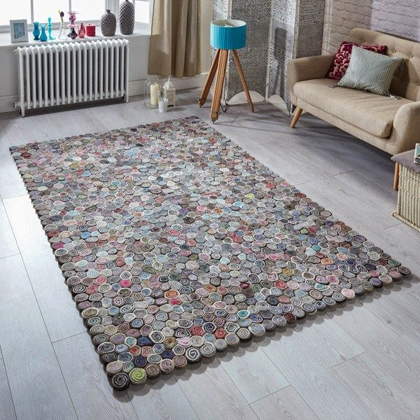 This Sushi Designer rug is handmade in  India using a blend of felted wool and polyester resulting in being water repellent. It's an excellent rug for your modern day room settings. #handmaderugs  #multicolouredrugs #woolrugs #polyesterrugs #largerugs #mediumrugs