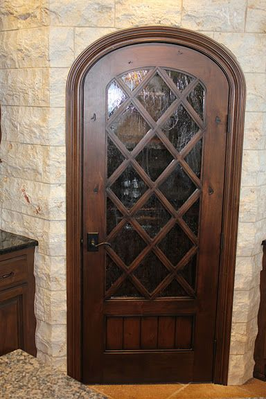 Wine Cellar Door made by Trustile Doors,  this is on display at McCray Millwork in Kansas City.