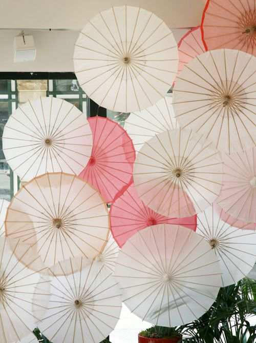 Event decorations inspiration: wall of parasols. Store window display for West Elm