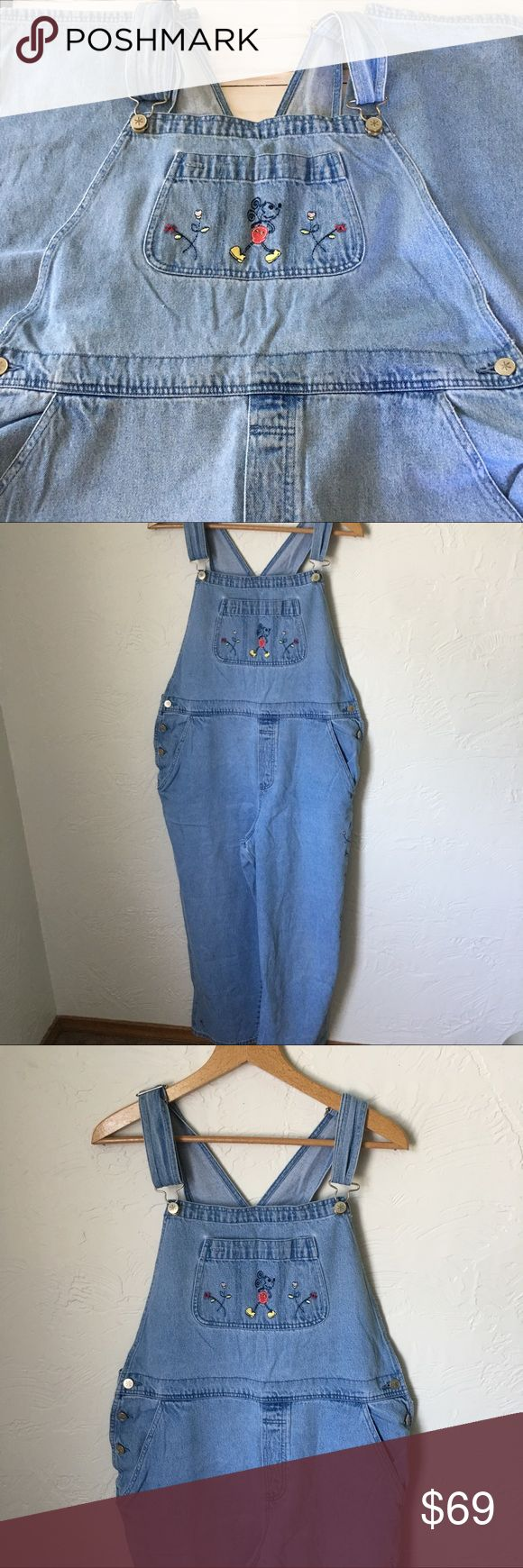 """Vintage Disney Mickey Mouse denim bib  overalls Vintage Disney Mickey Mouse denim bib overalls.  Embroidered Mickey Mouse and flowers in front bob pocket down left leg and on back.  18"""" waist measurement when laid flat. 13"""" rise 9"""" leg opening 56"""" in length. The straps are adjustable. Disney Jeans Overalls"""