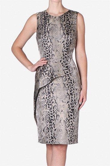 Lizard Print Elegance Chemise. Asymmetric peplum detailing creates a modern shape on this classic lizard print chemise taking it from day-to-night with ease. Pair with the Faux Croc Coat for an edgier look.