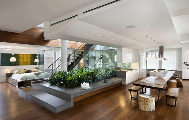 NYC penthouse apartment.  Love the Concrete Kitchen turning down into planter/seating.  Kitchen table is a nice object as well.