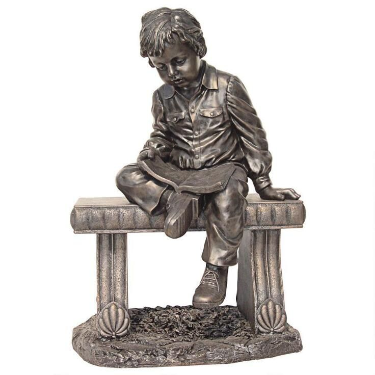 Charming statue of a young boy reading a book. This almost life size statue will delight the book lover in your life.